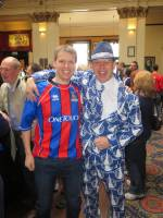 Falkirk fan in £200 custom made suit. ICT fan in jeans and an old top.