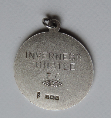 5976015f6698e_medalback.jpg.d3f10912094590dc54c2765060c8d73c.jpg